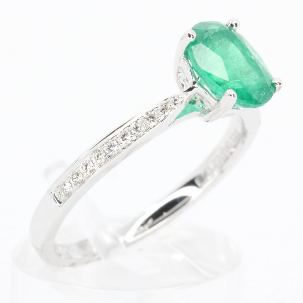 Oval Cut Solitaire Emerald Ring with Accents of Diamonds Set in 18ct White Gold