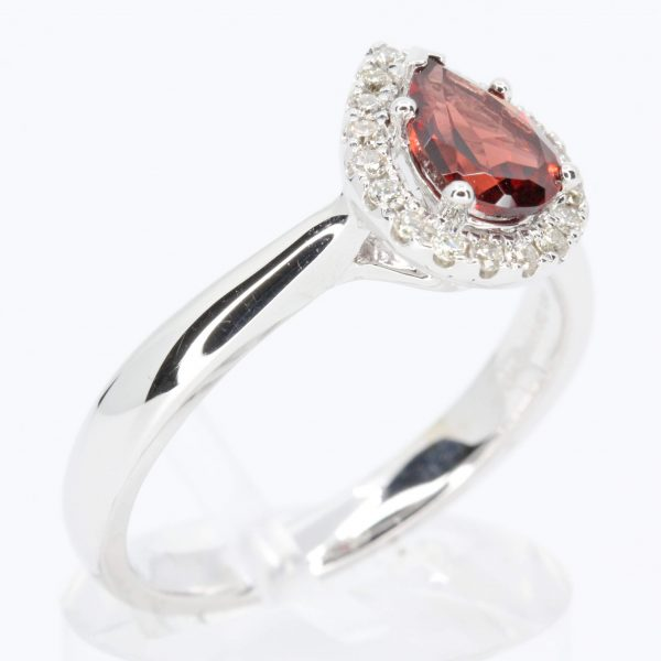 Pear Cut Garnet Ring with Halo of Diamonds Set in 18ct White Gold