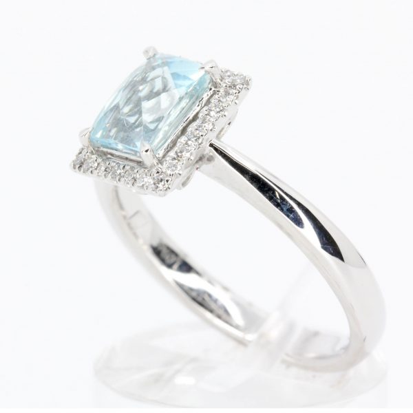 Emerald Cut Aquamarine Ring with Halo of Diamonds Set in 18ct White Gold