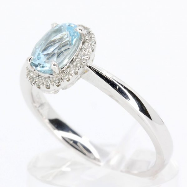 Round Cut Aquamarine Ring with Halo of Diamonds Set in 18ct White Gold