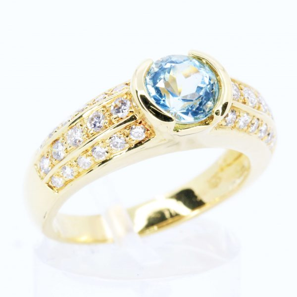 Round Cut Blue Topaz Ring with Accents of Diamonds Set in 18ct White Gold