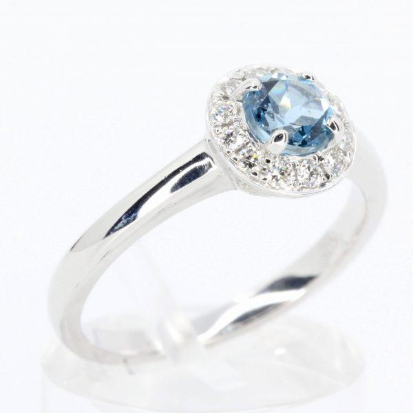 Round Cut Aquamarine Ring with Halo of Diamonds Set in 18ct White Gold