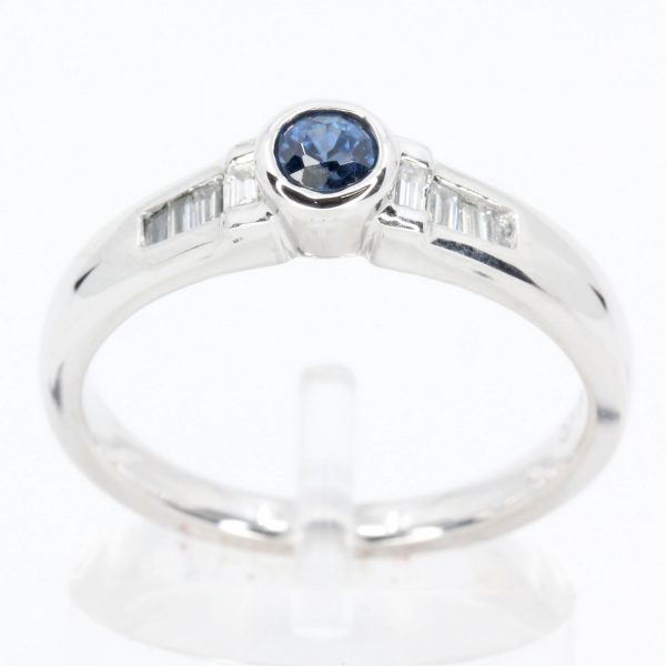Round Cut Solitaire Australian Sapphire Ting with Accents of Diamonds Set in 18ct White Gold