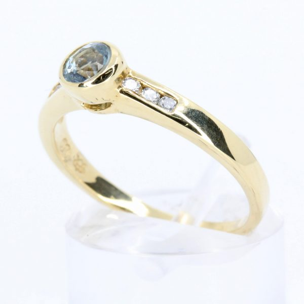 Round Aquamarine Ring with Diamond Accents Set in 18ct Yellow Gold