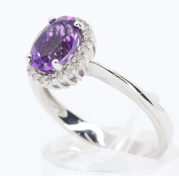 Oval Shape Amethyst Ring with Halo of Diamonds Set in 18ct White Gold