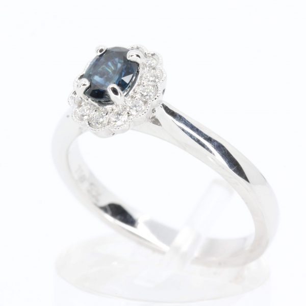 Oval Shape Australian Sapphire Ring with Grain of Diamonds Set in 18ct White Gold