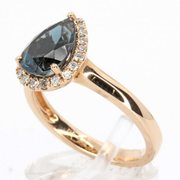 Pear Cut Lodon Blue Topaz Ring with Halo of Diamonds Set in 18ct Rose Gold