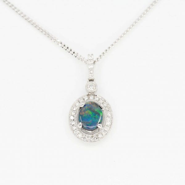 val Black Opal Pendant with Halo of Diamonds set in 18ct White Gold
