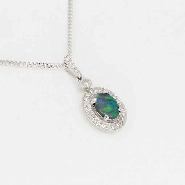 Oval Black Opal Pendant with Halo of Diamonds set in 18ct White Gold