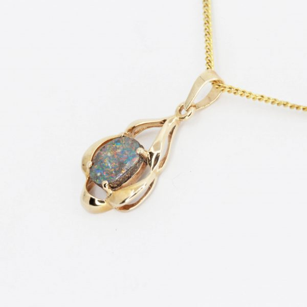 Oval Boulder Opal Pendant set in 9ct Yellow Gold