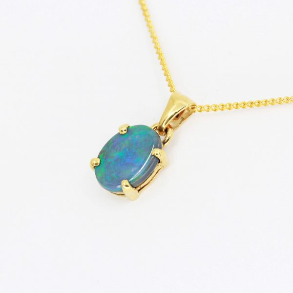 Black Opal Pendant set in 18ct Yellow Gold