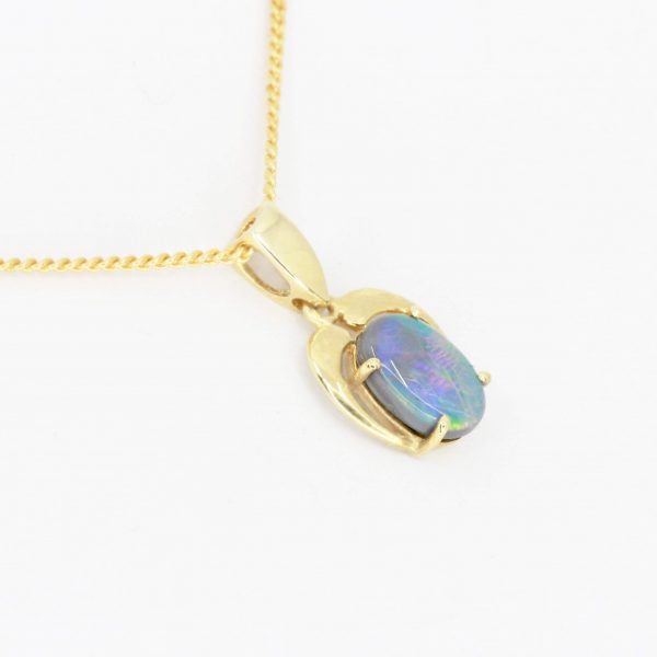 Black Opal Pendant set in 14ct Yellow Gold
