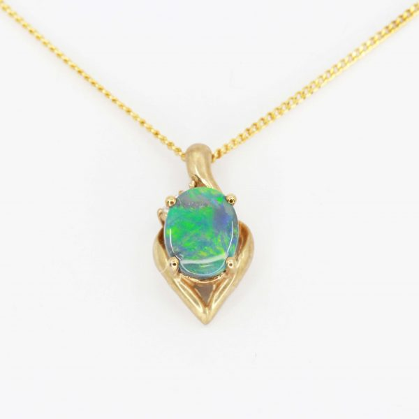 Black Opal Pendant with Diamonds set in 9ct Yellow Gold
