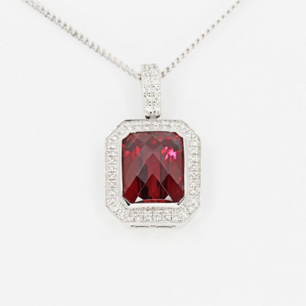 Checkered Cushion Rhodolite Garnet Pendant with Halo of Diamonds set in 18ct White Gold