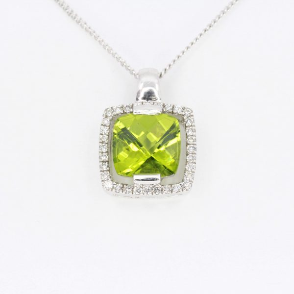 Cushion Cut Peridot Pendant with Diamonds set in 18ct White Gold