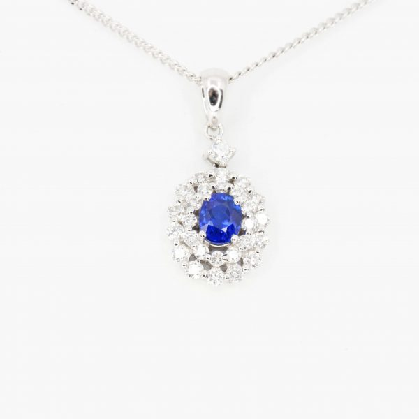 Oval Sapphire Pendant with Halo of Diamonds set in 18ct White Gold