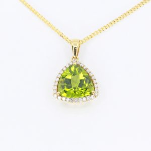 Trillion Cut Peridot Pendant with Diamonds set in 18ct Yellow Gold