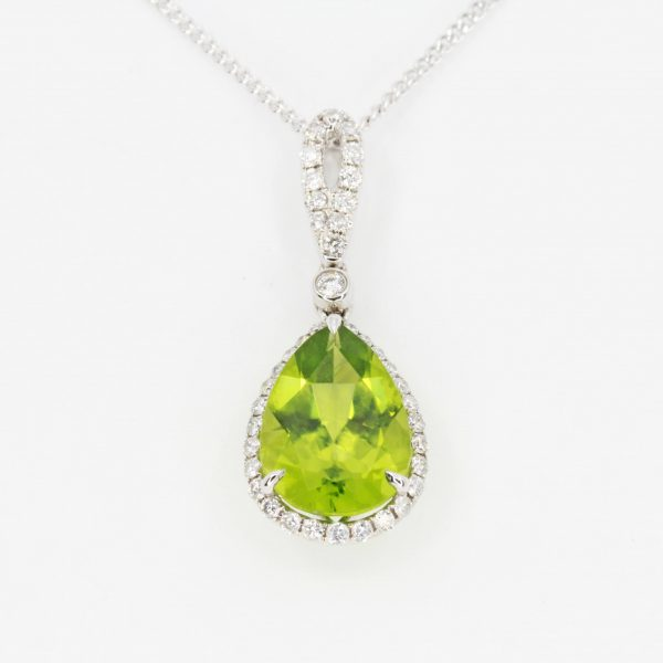 Pear Cut Peridot Pendant with Diamonds set in 18ct White Gold