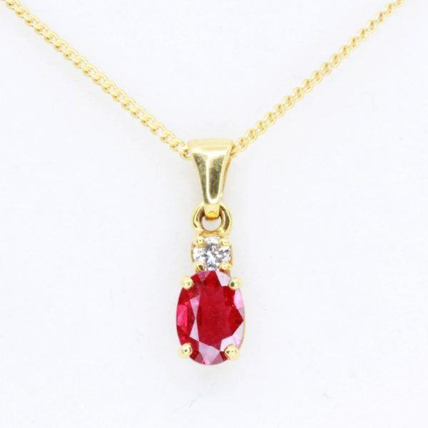 Oval Cut Ruby Pendant with Diamonds set in 18ct Yellow Gold