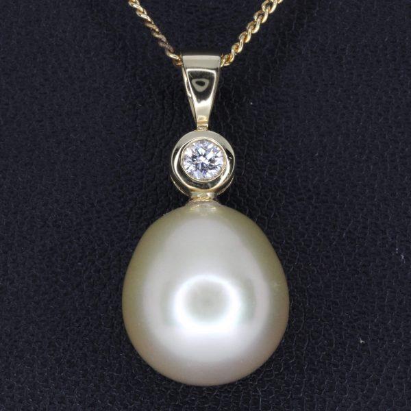golden south sea pearl pendant with diamonds