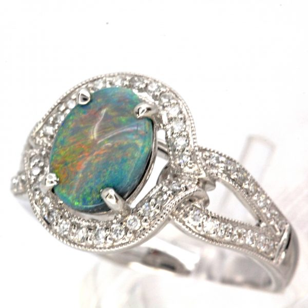Oval Grey Opal Ring with Halo of Diamonds set in 18ct White Gold