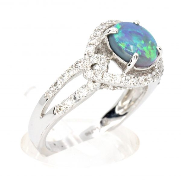 Claw Set Black Opal with Halo of Diamonds set in 18ct White Gold