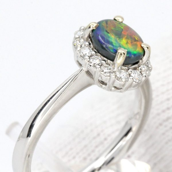 Oval Black Opal Ring with Halo of Diamonds set in 18ct White Gold