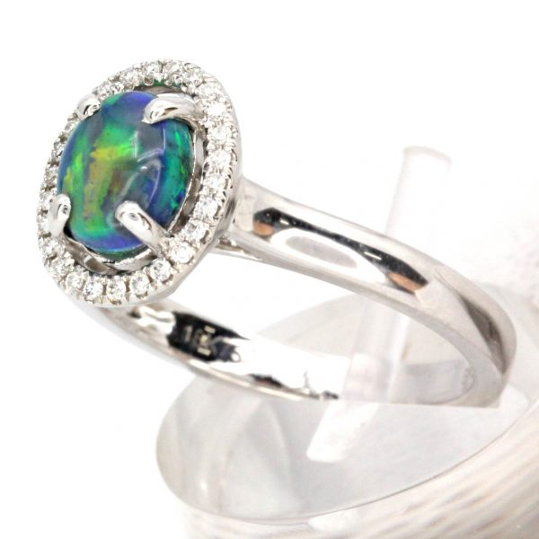 Oval Black Opal Ring with Halo of Diamonds
