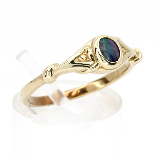 Oval Black Opal Ring set in 9ct Yellow Gold