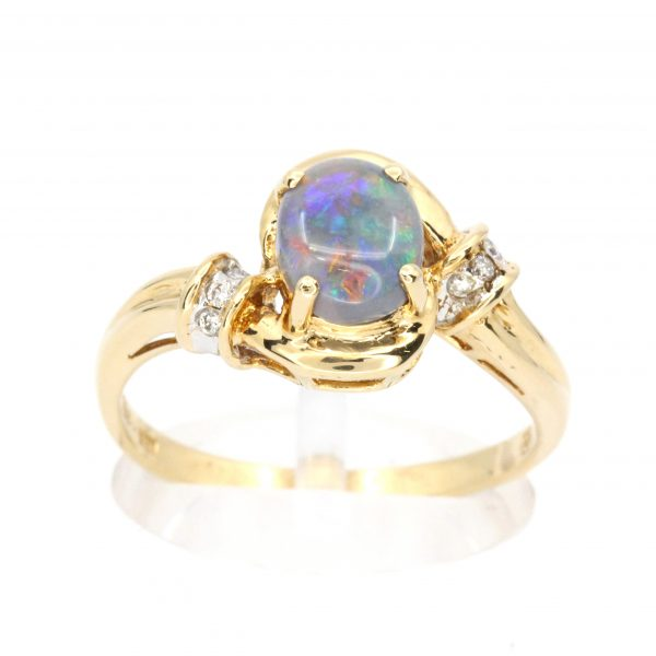 Oval Black Opal Ring with Halo of Diamonds set in 18ct Yellow Gold