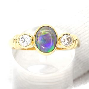Oval Grey/Dark Opal With Diamonds set in 18ct Yellow Gold