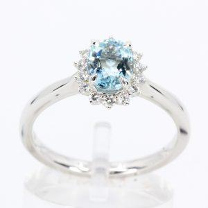 round cut emerald diamond ring